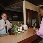 Ed Dunn, Account Development Manager, Brescome Barton talking with Prasad Maganti of Empire Wine and Liquor about the featured spirits, Tequila Cabeza and Cana Brava Rum.