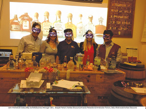 Behind the masks are John Markel, Sales, CDI; Kelly Scofield, Business Manager, CDI; Deepak Pattani, Owner, Yankee Discount Liquor; Amanda Pekar, Account Development Specialist, Patrón, CDI; and Babu Khatiwada, Manager, Yankee Discount Liquor.