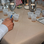 Guests casting their votes for favorite bourbon.