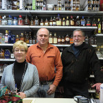 Owner Charles Kelly (center) with employees Victoria and Paul