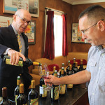 Tim Gilhooly pouring a sample of wine for David Galanto, Owner of The Wine Cask in Old Saybrook.