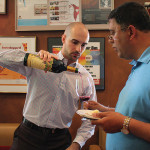 Nick Neves, Trade Development Manager, Worldwide Wines pouring for Vipul Gandhi, Stratford Spirit Shop.