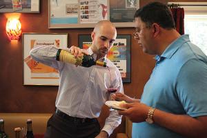 Nick Neves, Trade Development Manager, Worldwide Wines pouring for Vipul Gandhi, Stratford Spirit Shop.