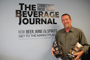John Maguire, Sales Representative, Ace Distributing with The Infinite Monkey Theorem canned wines.