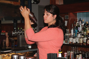 Jen Davis, United States Bartenders Guild Rhode Island (USBG RI) Chapter Member and Bartender at The Eddy, mixing cocktails.