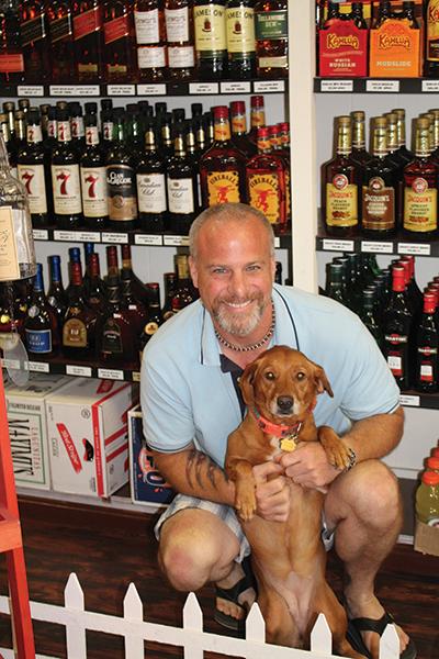 Owner M. Scott Lyons with store dog, Stella.