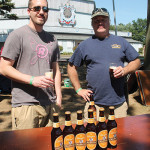 Volunteers Pat McLaine and Dave Heffern pouring Yuengling Oktoberfest for guests.