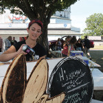 Jessica Rubin of Firefly Hollow Brewing in Bristol pouring beers for guests.
