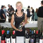 Lori Tunmer, Representative, Vine Ventures, pouring Palm Bay International Selections.