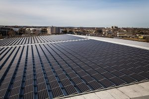 The solar panels are divided across two sections on the roof of CDI's 140,000 square foot facility in Stratford. Photo by Joe Palisi.