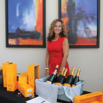 Maureen Pesticci, Compliance Manager, Slocum & Sons beside Vueve Clicquot offerings.