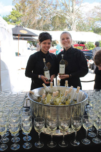 Andreana Dermatis and Nikki Gorman of Blackstone Caterers greeting guests with Robert Mondavi white wine upon entering the festival.