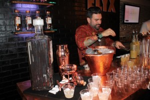 United States Bartenders Guild Connecticut (USBG CT) chapter President Dimitrios Zahariadis mixing cocktails featuring Absolut Elyx.
