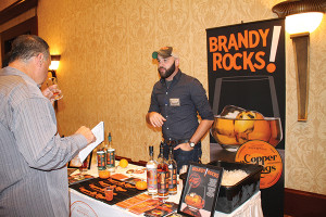 Christopher Wilkins of Copper and Kings American Brandy speaking with guests.