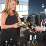 Donna Taylor of Vine Ventures pouring selections from Sterling Vineyards.