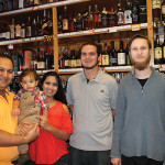 Mihir and Krupa Shah, with their son, and store employees Taylor Jackola and James Medley.