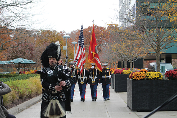 The U.S. Marine Corps Honor Guard led a presentation of the colors escorted by The Hampton Pipes and Drums.