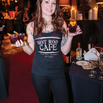 Kellie Fonnemann of Hot Rod Café in New London holding her prepared Bonnie Rose cocktail.