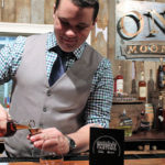 Jordan Szczygiel, Tasting Room, Onyx Spirits Company, poured samples for guests during the event.