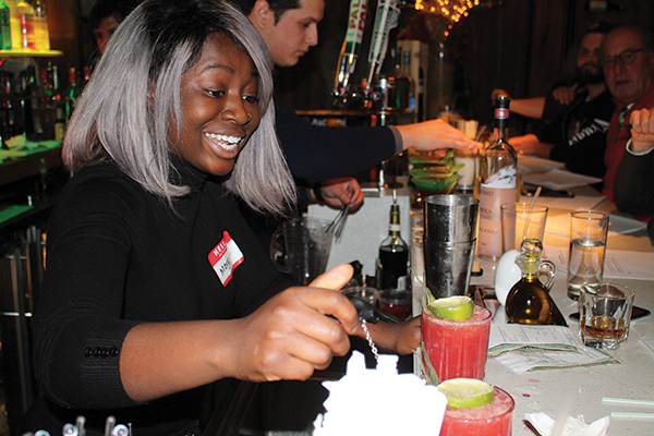 "Marjorie Maxi, first place winner, with her cocktail, ""How We Met."""