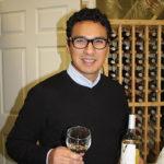 Milton Monzon, Commercial Director, J.C. Imports, holding Vivendo 2014 Reserve Sauvignon Blanc.