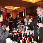 Steve Fanelli, Key Account Manager, Hartley & Parker speaking with Irene Tan, Owner, Brooklyn Wine & Spirits.