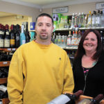 Owner Anthony Lewis and store employee Jess Tilley.