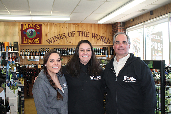Lauren Guida, Employee; Michelle Sousa, Store Manager, and Robert Guida, Owner.