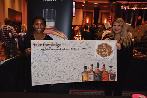 """Brown-Forman and Twin River Casino also presented """"Take the Pledge"""" to drive safe and sober, gathering signatures from all participants."""
