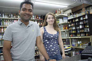 Owner Neil Patel with store employee, Patricia Montville.