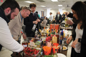 Zone teams creating cocktails, which were judged on name, ease of build, appearance and taste.