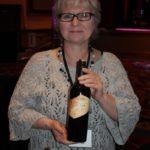 Lynda Ross of The Tasting Company holding Ferrari-Carano Siena of Sonoma County.