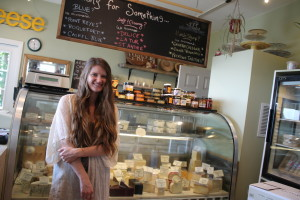 Amelia Wilson besides the cheese case.