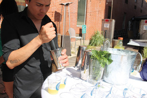 "Christtian Hurtado muddling basil leaves for his cocktail ""Green Goddess."""