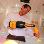 Michael Kolesar, Bar Manager, L'escale inside the Veuve Clicquot Yellow Mailbox Truck pouring champagne samples for guests.