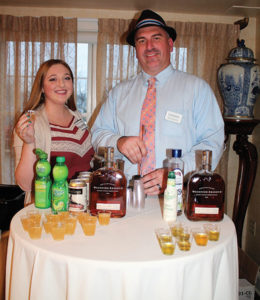 Nicollett Burns and Craft Spirit Specialist Jeff Conelius of Allan S. Goodman featuring Woodford Reserve in cocktail samples.