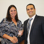 """During the Hartley and Parker sales meeting, Domenick Italiano, Distributor Manager for Diageo, presented Hartley and Parker Sales Representative Melissa Romano with a """"Diageo Sales of Excellence"""" award. Romano was awarded for sales achievements of Diageo products."""