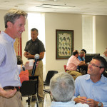 Doug Bowie answering questions from Brescome Barton sales staff. John Taylor is in the background.