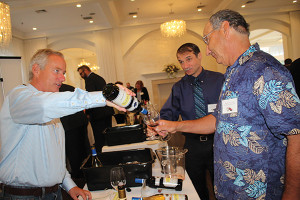 James Teegan, Northeast Sales Manager, Rombauer Vineyards pouring samples for Ken Chicoria and Clark Nicholas of Hopkinton Liquor Depot.
