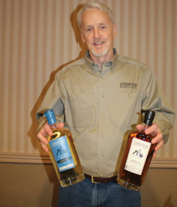 David Baker, Owner, Litchfield Distillery with its newest releases, Barrel Finished Gin and Vanilla Bourbon.