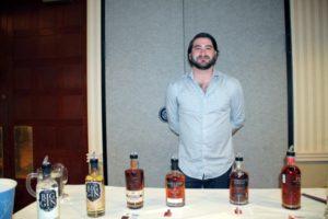 Alex Schlien, Merchandiser, Slocum & Sons showcasing Pendleton Whiskey, Trail's End and Big Gin.