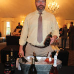 Adam Baker of Allan S. Goodman pouring samples from 14 Hands and Chateau Ste. Michelle.