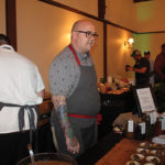 Chef Tyler Anderson of Millwrights in Simsbury speaking with guests during the Taste of Farmington.