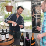 John Tsipouras, Sales Representative, Slocum & Sons pouring tastes for Greg Marcuson, Chef and Owner, Cure Restaurant.