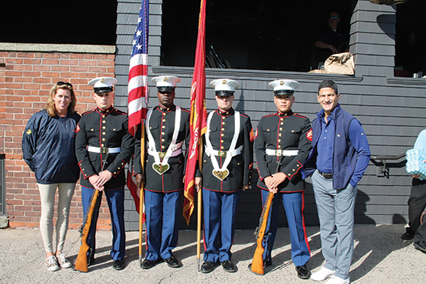 Sue Boulhosa, Executive Director, Marine Corps Law Enforcement Foundation; Lance Cpl. Michael Schebell; Sgt. Mario Williams; Sgt. Matthew Smith; Cpl. Thomas Hecht; Gene Sepe, CEO and President, Brescome Barton.