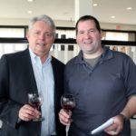 Jim Jansson, guest, Harry's Wine and Liquor Market with Scott Hill, employee, Harry's Wine and Liquor Market.