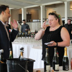 Carl Vitale, Divisional Manager South, Winebow showcasing sparkling selections to Betty Swietak, BevMax.