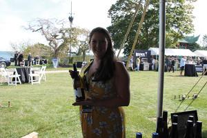 Molly Peabody, Sales Representative, M.S. Walker with Newport Vineyards wine.