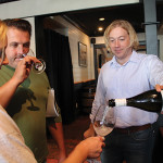 Matt Barcewicz, Connecticut Sales Representative, Michael Skurnik Wines, pouring a sample for Christopher and Melissa Jeans of Casa Bacchus Wine Shoppe in Litchfield.