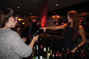 Samantha Kelman, CSW, CSS, State Manager, On-Premise Connecticut and New Hampshire, E. & J. Gallo Winery, pouring wine sample for trade guests.